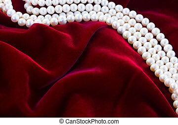 red velvet background with pearls