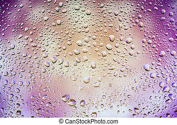 Abstract texture. Water drops on glass with purple background
