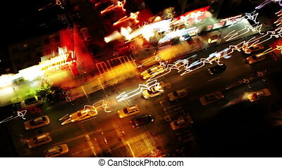 abstract time-lapse looking down onto a new york street of fast moving traffic at night