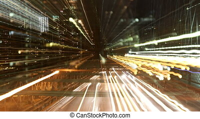 abstract timelapse of brooklyn bridge at night, new york