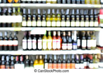 abstract, verdoezelen, of, defocus, achtergrond, van, flessen van de wijn, op, plank, in, supermarkt