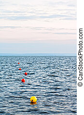 Abstract view of sea with buoys.