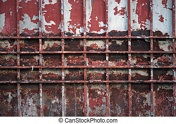 Abstract vintage steel door eroding rust.
