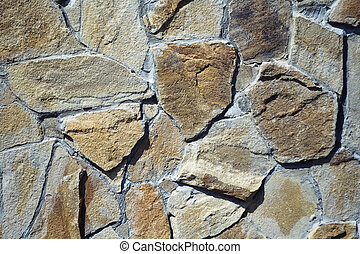 abstract wall background with many different stones