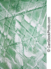 Abstract watercolor background with green layers on paper