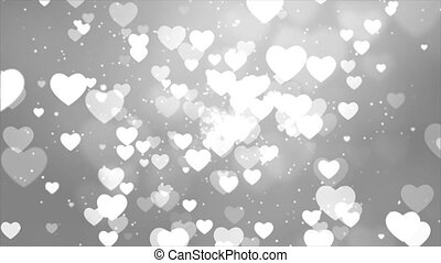 Abstract White Hearts Particle bokeh floating on black screen background Loop Animation.