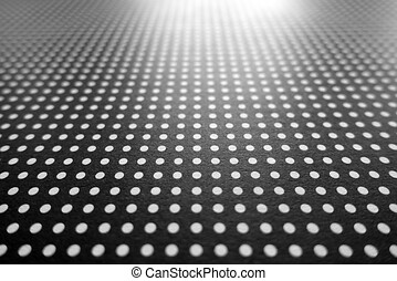 Abstract White Polka Dots on a Black Background with Blurred...