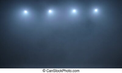 Abstract white spot light with smoke on a dark background