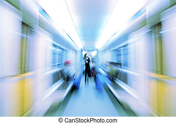 abstract woman in metro wagon in blur