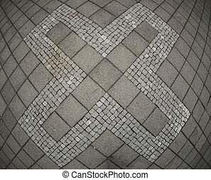 Abstract X symbol on concrete tile