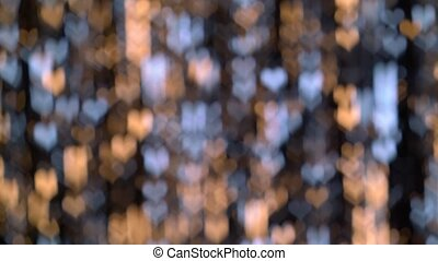 Abstract yellow and blue lights heart shaped. Bokeh background