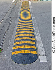abstract yellow stripped road barrier for cars on asphalt, security details