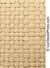 Close up of abstract yellow woven thatch textured background