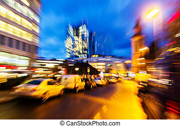 abstract zoom picture of a street scene in the city at night