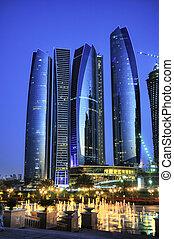 Abu Dhabi city by night - Skyscrapers in Abu Dhabi at dusk, ...