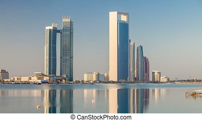 Abu Dhabi city skyline with skyscrapers after sunrise with...
