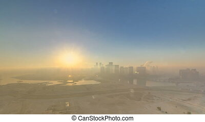 Abu Dhabi city skyline with skyscrapers at sunrise from...