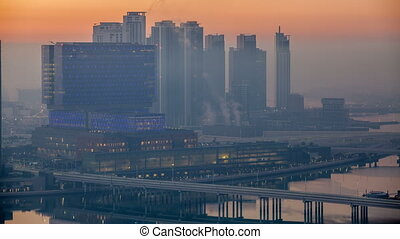 Abu Dhabi city skyline with skyscrapers before sunrise from...