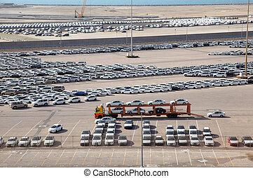 ABU DHABI, UAE - APRIL 15: Big warehouse of cars on April 15...
