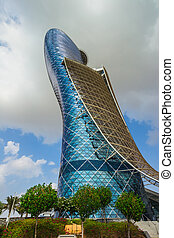 ABU DHABI, UAE - NOVEMBER 5: The Capital Gate Tower on the November 5, 2013 in Abu Dhabi, This is certified as the World's Furthest Leaning Manmade in the world. it is in the heart of the business area.