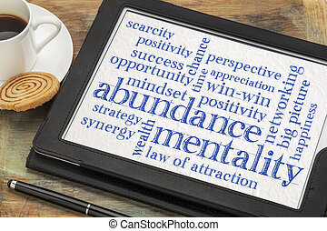 abundance mentality word cloud on a digital tablet with a ...