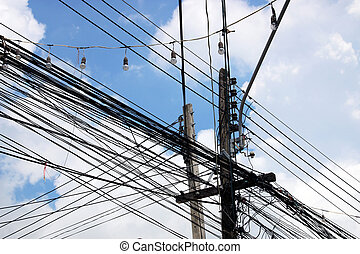 Abundance of Power Lines Connected to Wooden Poles
