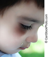 Abused child - Crying kid with red welt below his eye and...