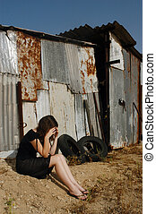 Abused Victim - A woman who is a victim of abuse is sitting...