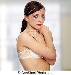 Abused woman crying