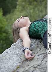 social crime scene - abused and unmoving woman lying on the ground