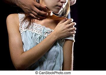 Abusive Man Behind a Female Victim - Oppressive man behind a...