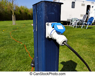 AC power sockets at a camping site, Full service campground...