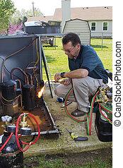 AC Repair - Technician replacing AC condenser & filter...