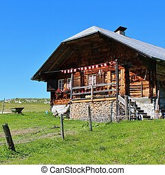 acade of a old house in the Simmental Valley.
