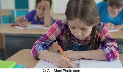 Academic Performance Assessment - Close up of girl at...