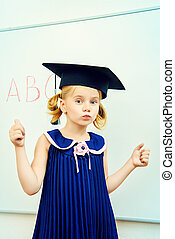 academic pupil - Cute little student girl in academic hat...