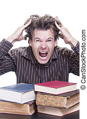 Academic stress - Young male Caucasian student reacts...