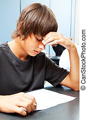 Academic Testing Anxiety - Teen boy taking an objective test...