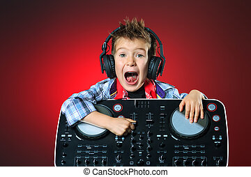 academy of music - Expressive little boy DJ in headphones...
