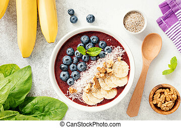 Acai smoothie bowl with blueberry, banana, walnut, coconut and chia seed