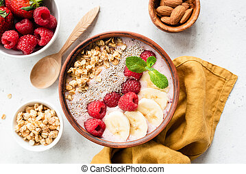 Acai smoothie bowl with superfood top view