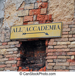 Accademia sign on brick wall - Sign on old brick wall ...