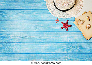 Accessories for travel top view on blue wooden background