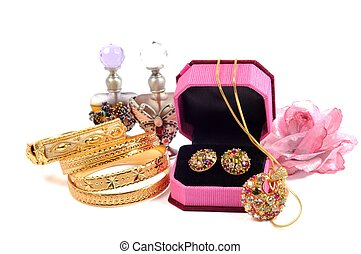 Golden set and gold bracelets with accessory, over white