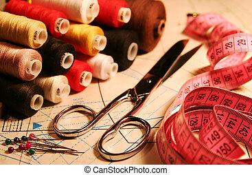 scissors, stitching, measuring tape