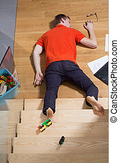 Accident at home - man falling down from the stairs
