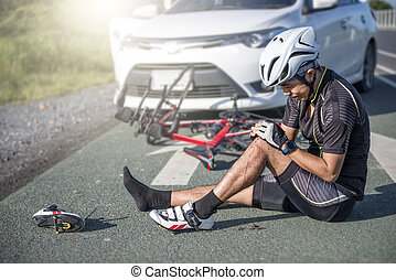 Accident Concept, Unconscious male cyclist lying on road