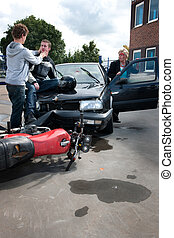 Accident - Inured woman getting out of her car to see the...