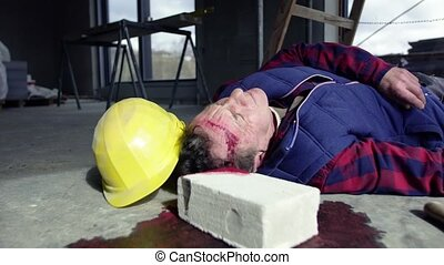 Accident of a man worker at the construction site.