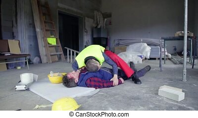 Accident of a man worker at the construction site. -...